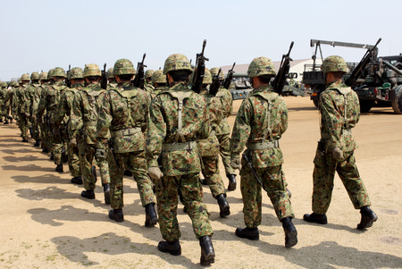 Japanese armed marching soldiers with rifle