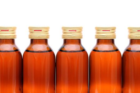 brown medicine bottle on white background photo