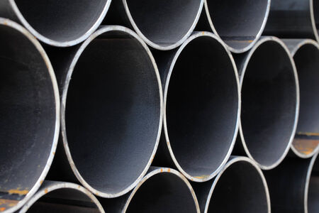 oxidize: Stack of steel pipes