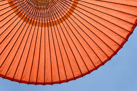 Japanese red umbrella on the blue sky photo