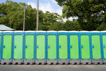 row of portable toilets for outdoor photo