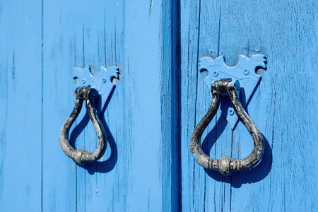 Old blue wooden door with round handles photo