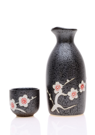 black cherry: Traditional Japanese sake cup and bottle on white background