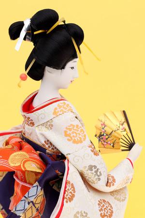 kanzashi: Japanese geisha doll isolated on white background