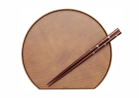 Chopsticks and plate isolated on a white background photo