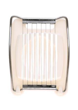 slicer: Egg slicer kitchen utensil isolated on white background Stock Photo