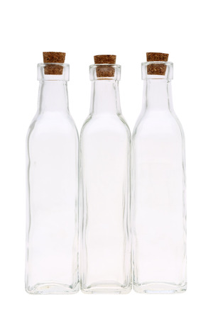 stopper: glass bottle with cork stopper isolated on white background