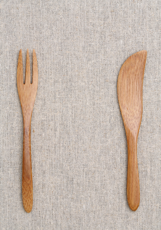 Wooden fork and knife on the table photo