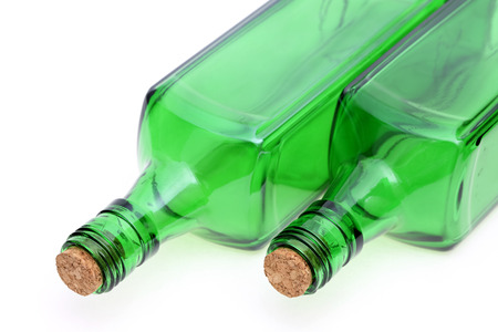 stopper: alcohol bottle with cork stopper isolated on white background