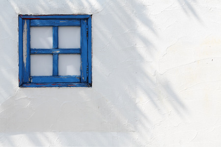 small wooden windows on the white wall photo