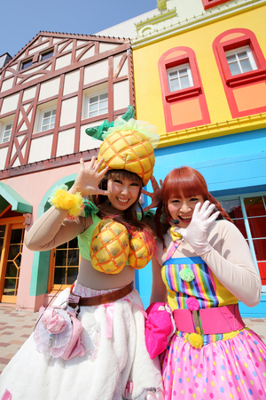 participate: KAGAWA, JAPAN - MARCH 13: Dancers in colorful costumes participate in a parade, celebrating Reoma World Theme Park Renewal Open Anniversary on March 13, 2015 in Marugae, Kagawa, Japan