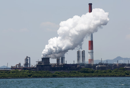 Industrial refinery plant with smoke air pollution