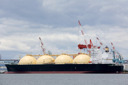 tanks: LNG cargo ship docked in the port Stock Photo