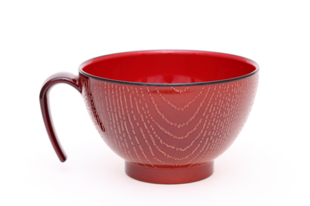 lacquer ware: Japanese wooden cup isolated on white background