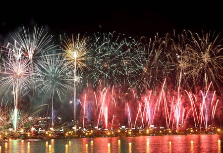 hanabi: colorful fireworks reflect on sea water Stock Photo