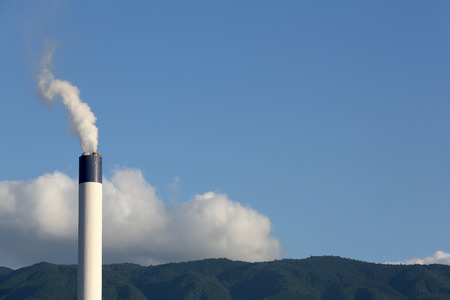 smoke stack: Industrial refinery plant with smoke stack