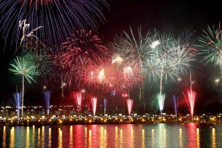hanabi: colorful fireworks reflect on sea water Stock Photo