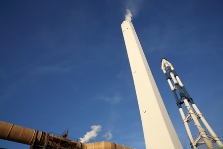 smoke stack: Industrial plant with smoke stack Stock Photo