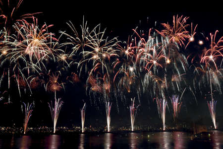 reflect: Beautiful colorful fireworks reflect on sea water