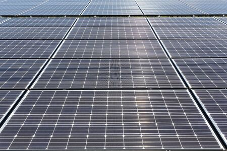 sun energy: solar panels in the power plant for renewable energy Stock Photo