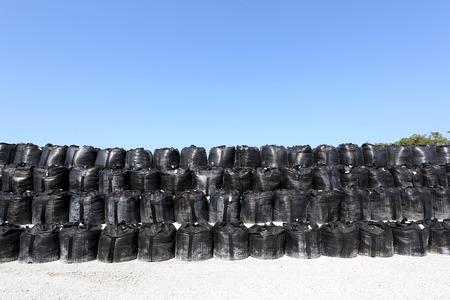 deluge: stack of toxic substance bag against a blue sky