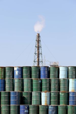 smoke stack: stack of oil barrels with smoke stack