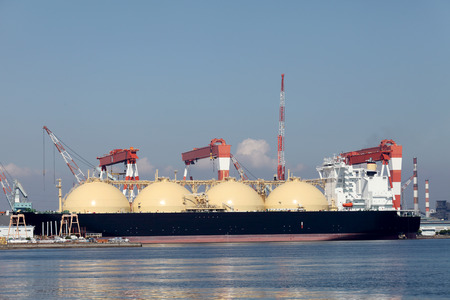 LNG cargo ship docked in the port Stock Photo