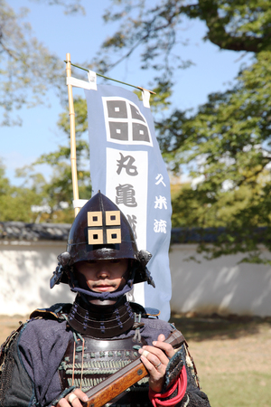 historical battle: KAGAWA, JAPAN-OCTOBER 25: Ancient firelock rifle fighters at Marugame Historical battle Festival, event dedicated to Japanese culture and tradition at Marugame-castle on October 25, 2015 in Japan.