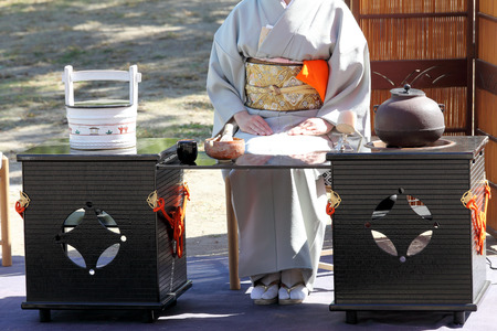 japanese tea garden: KAGAWA, JAPAN-OCTOBER 25, 2015: Japanese woman in traditional kimono prepares the tea ceremony at garden of the Marugame-castle on October 25, 2015 in Kagawa Japan.