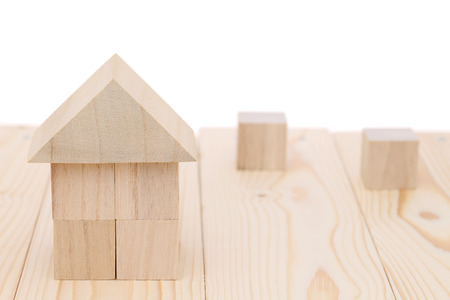 toy house: Wooden toy house with natural colored toy blocks Stock Photo