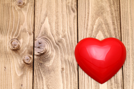 love image: heart shape on grunge wooden background with copy space Stock Photo