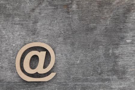 email symbol on grunge wood background