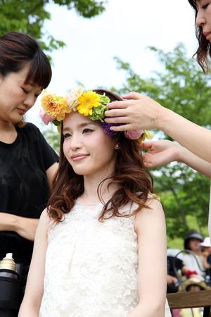 KAGAWA, JAPAN-MAY 15, 2016: Bride in a Zentuji-gogakunosato park getting ready for her wedding, Beautician makes young beautiful bride bridal make-up.