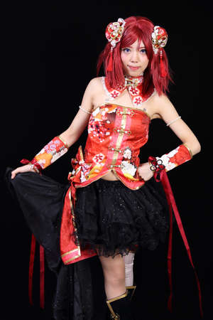 fanatic studio: Young asian girl dressed in cosplay costume on black background Stock Photo
