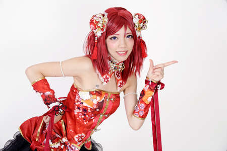 fanatic studio: Young asian girl dressed in cosplay costume on white background