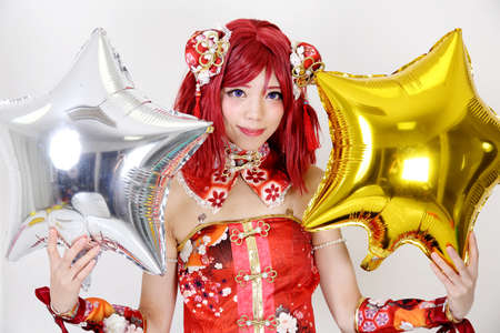 fanatic studio: Young asian girl dressed in cosplay costume with balloon