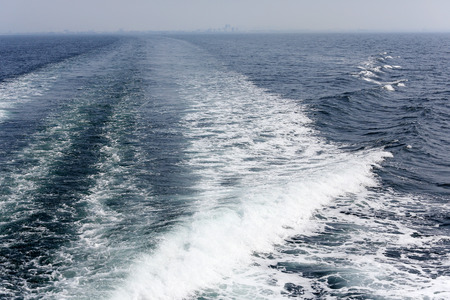 Cruise ship wake on the sea surface, ocean boat foam trail