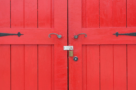oxidize: closeup of old wooden red door with metal handle Stock Photo