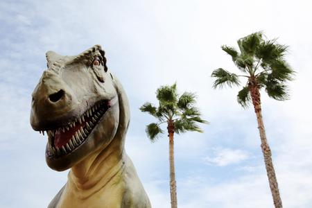 tyrannosaurus dinosaur and sky background Banco de Imagens