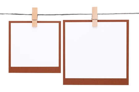 blank photo: Photo frame hung on rope with clothespin
