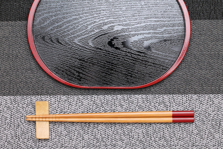 hashi: Chopsticks and empty tray on table background