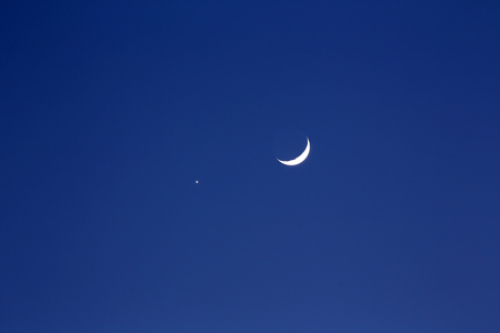 crescent: crescent moon and planet venus, dark blue background Stock Photo