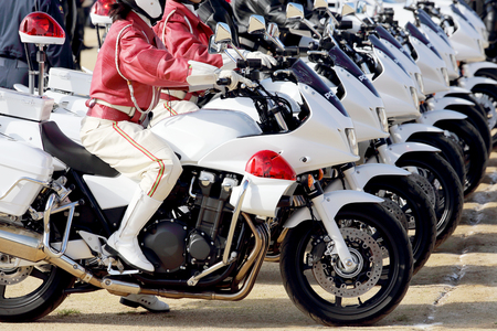 a white police motorcycle: Row of Japanese police woman on motorcycle