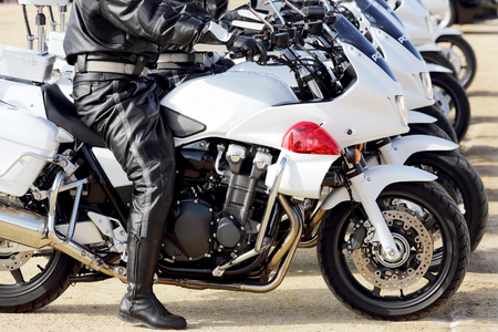 a white police motorcycle: Japanese police man on motorcycle Stock Photo