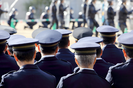 Back view of Japanese police officers 写真素材
