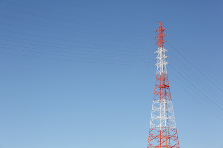 View of electricity pylon against a clear blue sky Stock Photo