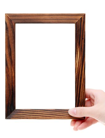 tableau: Hand holding wooden picture frame on white background