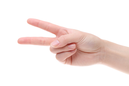 woman hand shows victory gesture isolated on white background
