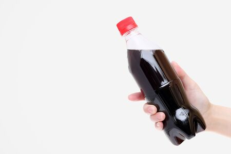 unhealth: Hand holding juice in a plastic bottle Stock Photo