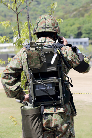 Kagawa, Japan-April 23 2017: Japanese soldier is shouldered transceiver at the Zentuji military base Kagawa, Japan Self Defense Forces